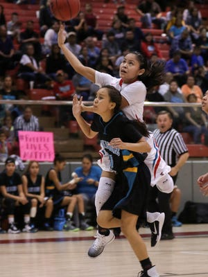 Shiprock's Melanie Secody shoots over Navajo Prep's Tiana Sandoval in the first quarter on Thursday at the Cheiftain Pit in Shiprock.