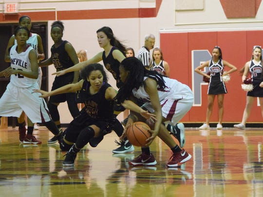 ASH's Megan Price tries to steal the ball from Pineville's