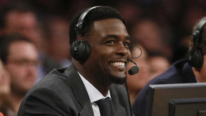 TNT commentator Chris Webber smiles during a game between the Portland Trail Blazers and Los Angeles Lakers on April 1, 2014.