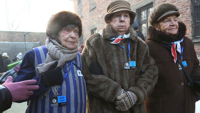 Holocaust survivors commemorate people killed by the Nazis at the former Auschwitz Germany Nazi death camp in Oswiecim, Poland, Friday, Jan. 27, 2017, on the International Holocaust Remembrance Day.