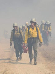 Crews with the U.S. Forest Service fight work to put out a brush fire Thursday near the Vandenberg Air Force Base.