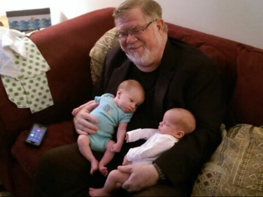 Jared Thomas of Melbourne is seen with his twin grandsons.