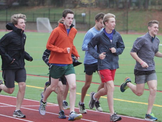 Pleasantville's boys cross country team practices at