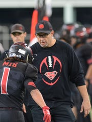 Strawn coach Dewaine Lee congratulates Carlos Villanueva after returning a kickoff for a touchdown against Balmorhea in the 2017 Division II state championship game in 2017.