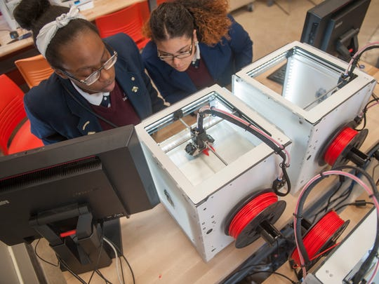 LEAP Academy Charter School students Rickea Bell and Thalia Gracia work with a 3-D printer in LEAP Academy Charter School's Fabrication Laboratory in Camden. The 'Fab Lab' aims to boost interest in engineering professions.