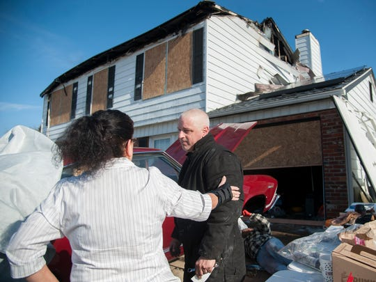 Joe Parisi speaks with neighbor Barbara Collins after Collins gave Parisi a check on Wednesday, after Parisi's Williamstown home was destroyed by fire Sunday morning.   Parisi's daughter Donna, 25, is a volunteer firefighter with the Williamstown Fire Company.  The fire company launched a collection for the family Monday seeking monetary donations and gift cards for groceries and essentials.