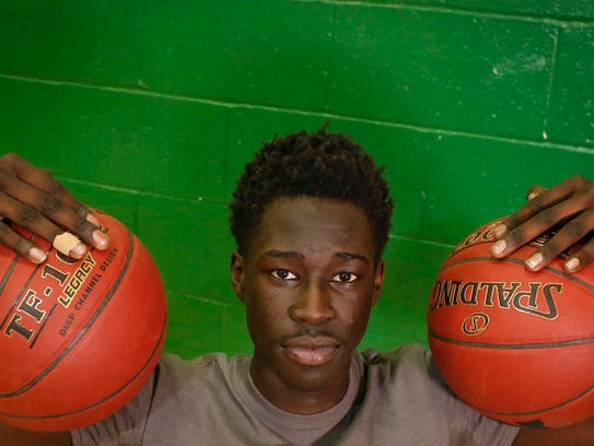 Des Moines North junior Lino Malual poses for a photo