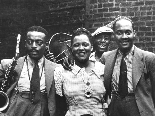Legendary jazz singer Billie Holiday with musicians including Ben Webster, left, and Johnny Russell, right, in Harlem in 1935. A Black History Month program on theHarlem Renaissance and the birth of jazz takes place Friday at theNashville Public Library's Richland Park branch.