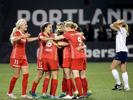 Portland Thorns players celebrate after Jodie Taylor scored the tying goal against the Washington Spirit during the second half.