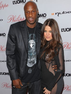 Lamar Odom and wife Khloe Kardashian arrive at the
