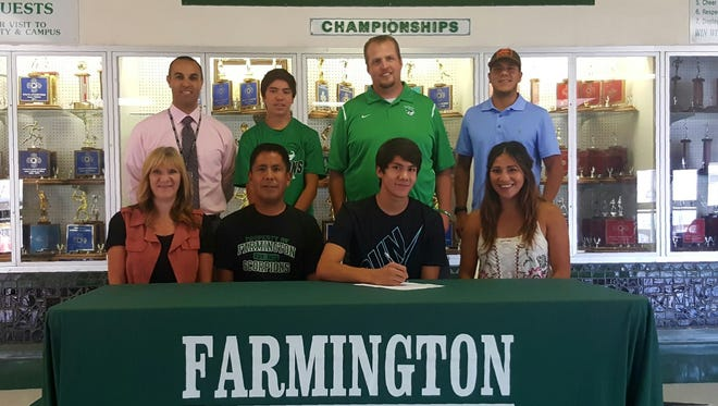 Clayton Corley signs a letter of intent to compete for the University of the Southwest track and field team on Wednesday at Farmington High School.