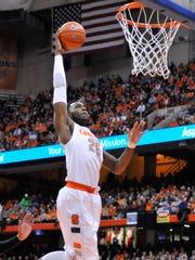 Syracuse Orange forward Rakeem Christmas (25) dunks