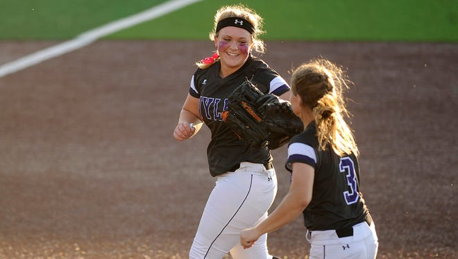 Wylie pitcher Kamwren Jackson (10) celebrates with teammate Kaylee Phillip (3) after a strikeout to end the top of the fifth inning of the Lady Bulldogs' 1-0 win over Brownwood in the District 5-4A tiebreaker on Friday, April 21, 2017, at Poly Wells Field.