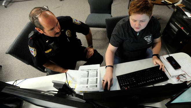 Pockets Cash (right) systems administrator for the city of Abilene and Abilene Police Department, works with APD Lt. Scott Rowley using the police department's newly installed public safety software on Thursday, May 4, 2017, at the Abilene/Taylor County Law Enforcement Center.