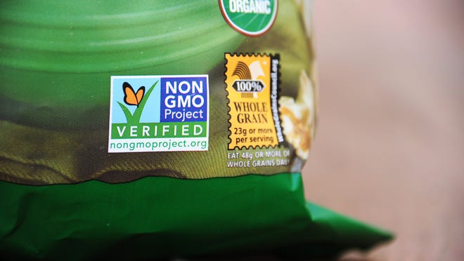 """A label on a bag of popcorn indicates it is a non-GMO food product, in Los Angeles, California,  October 19, 2012.  California could become the first US state to enforce labeling of genetically modified foodstuffs also know as GMO's, in a vote next month pitting agro-chemical manufacturing giants against die-hard opponents of so-called """"frankenfoods.""""  The state will vote on November 6 ? the same day as the White House election ? on the ballot initiative, which backers claim will let consumers know exactly what they are eating, but critics say will pander to unjustified fears about genetic engineering. AFP PHOTO / ROBYN BECK        (Photo credit should read ROBYN BECK/AFP/Getty Images)"""