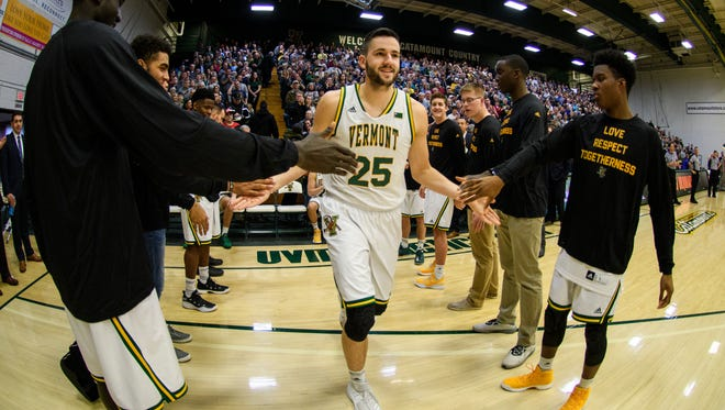 Vermont's Drew Urquhart (25) takes the floor during player introductions in the men's basketball game between the Stony Brook Seawolves and the Vermont Catamounts at Patrick Gym on Saturday afternoon January 13, 2018 in Burlington.
