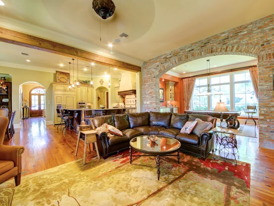 Gorgeous wood floors and brick arches are featured