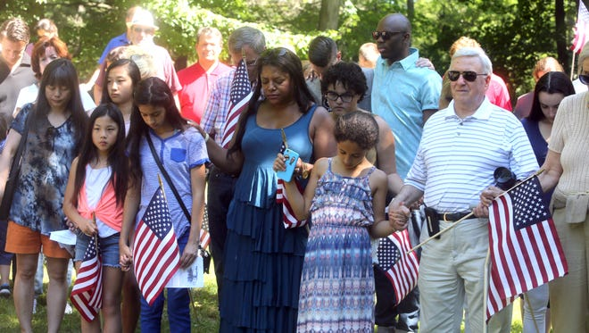 After more than 35 American flags were torn from sticks at gravesite at the historic Rye African American Cemetery, members of the community came together for ceremony of solidarity June 18, 2016. About one-hundred attended the ceremony, held by the Friends of the African American Cemetery in Rye. New flags were planted at the graves, and the bare sticks remained as reminder of the act of vandalism.