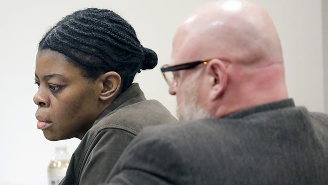 Mastella Jackson, 39, appears in court with defense attorney Jon Padgham during closing arguments Wednesday in Outagamie County court. The jury convicted Jackson of stabbing her husband Derrick Whitlow to death in 2012 in a Grand Chute motel.