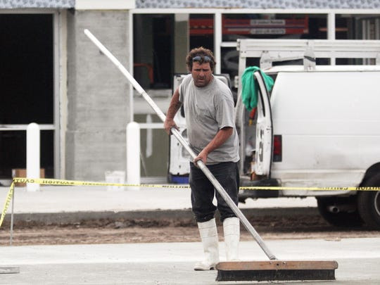 Kevin Simpson roughs up some cement to give it a nonslip texture while construction continued at the new Wawa service station on the corner of Del Prado and Pine Island Road Thursday morning in Cape Coral.