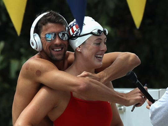 """A word from Michael Phelps helped jolt Allison Schmitt out of her funk. """"I'm glad to see the old Allison back ... laughing and smiling,"""" he said. """"A happy swimmer is a fast swimmer."""""""