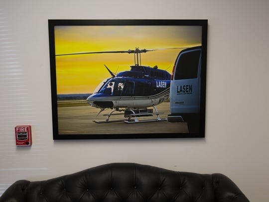 A photo of one of the LaSen Inc. helicopters hangs in the lobby of the corporate headquarters of the company in Las Cruces.