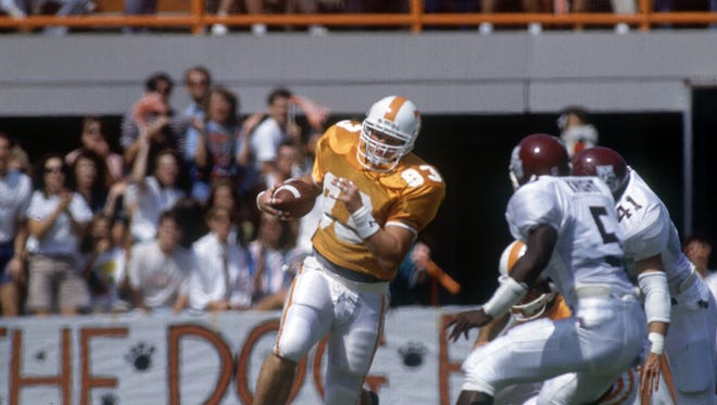 Tennessee tight end Mark Adams runs with the ball in a game during the 1991 season.