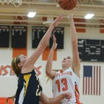 JOHN HEIDER | STAFF PHOTOGRAPHER  Northville Mustang Jessica Moorman puts up a shot against Walled Lake Central on Dec. 12 at Northville's home opener.