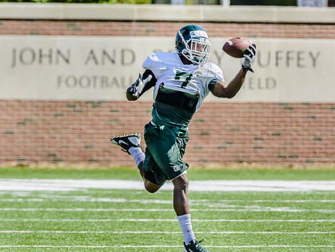 MSU safety Demetrious Cox makes a one-handed grab in a drill during day 15 of summer camp Thursday August 14, 2014 in East Lansing.