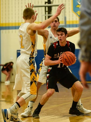 Harding senior guard Tyler Longstreth fights through a trap in a regular season boys basketball game at River Valley. Longstreth was named Fahey Bank Athlete of the Month for Febraury.