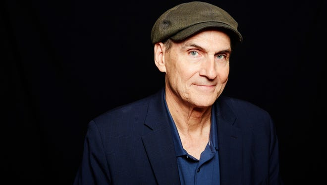 "Grammy Award winning singer-songwriter James Taylor poses for a portrait in New York on May 13, 2015. Taylor released his latest album, ""Before This World,"" this week."