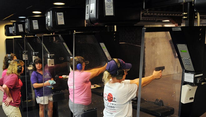 The Brevard County (Fla.) Ladies Shooting Chapter of The Well Armed Woman have target practice at the Shooting Center, an indoor range located inside the American Police Hall of Fame & Museum, in Titusville, Fla.