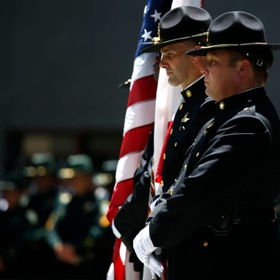 The Leon County Sheriff's Office Color Guard marches