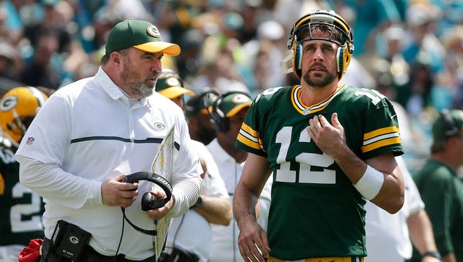 Green Bay Packers quarterback Aaron Rodgers (12) and coach Mike McCarthy talk after some miscommunication in the offense vs. Jacksonville.