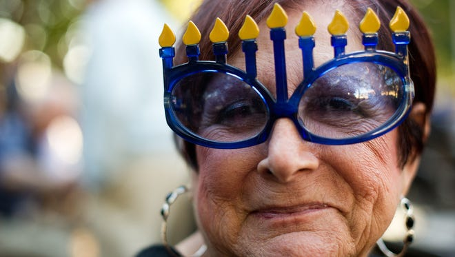 Naples resident Sanda Jaffe sports some Menorah during a Hanukkah celebration hosted by Chabad Naples in Cambier Park, Naples, Tuesday, December 16, 2014. (Logan Newell/Special to the News-Press)