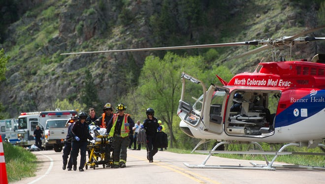 A runner in the Colorado Marathon, who collapsed in the Poudre Canyon, is transported to a med evac helicopter Sunday, May 7, 2017. The runner remains in critical condition in Medical Center of the Rockies in Loveland.