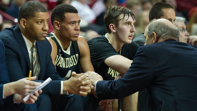 Vanderbilt coach Kevin Stallings (right), guard Wade Baldwin (second from left), Luke Kornet and the Commodores know they need to notch a quality win soon to be in the NCAA Tournament mix.