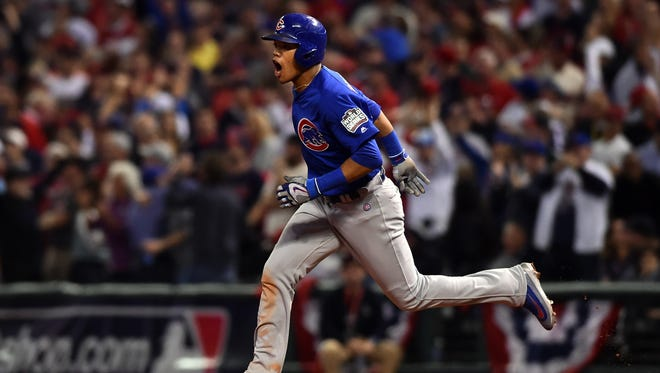 Chicago Cubs shortstop Addison Russell celebrates after hitting a grand slam against the Cleveland Indians in the third inning in game six of the 2016 World Series at Progressive Field in Cleveland.