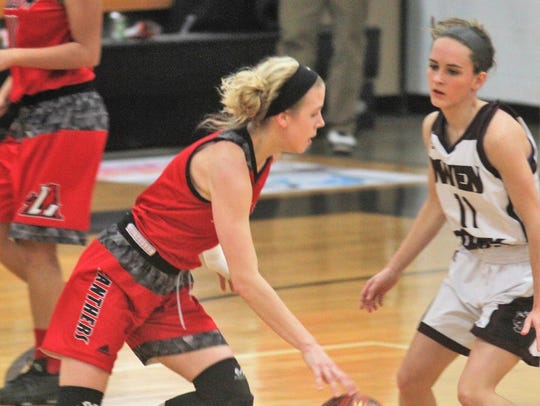 Ludlow sophomore Abby Mahan drives inside during Ludlow's