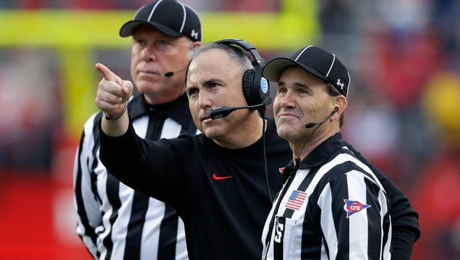 Former Rutgers coach Kyle Flood argues a call with the officials in his final game at the helm.