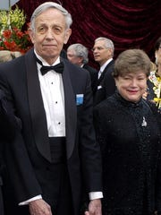 John Nash, left, and his wife, Alicia, arrive at the