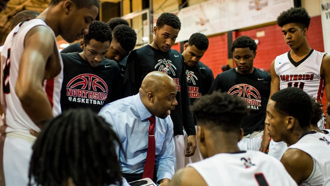 Northside head coach Ross Rix speaks to players during a time out in an LHSAA boys' basketball game against St. Thomas More at Northside High School in Lafayette, LA, Monday, Jan. 26, 2015. Paul Kieu, The Advertiser