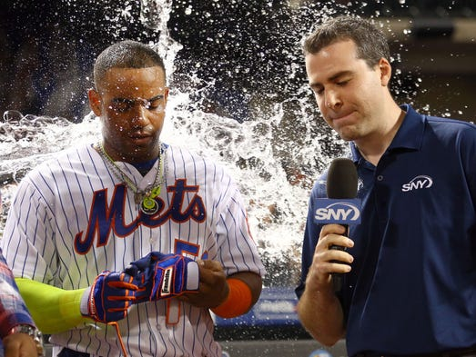 Aug. 29: Mets left fielder Yoenis Cespedes is doused