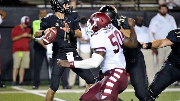 Vanderbilt quarterback Patton Robinette looks to throw the ball downfield against Temple.