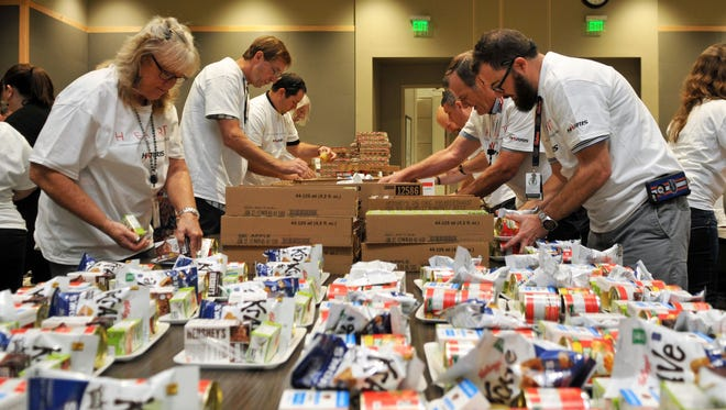 Harris Corp. employees recently volunteered to package meals for the Children's Hunger Project.