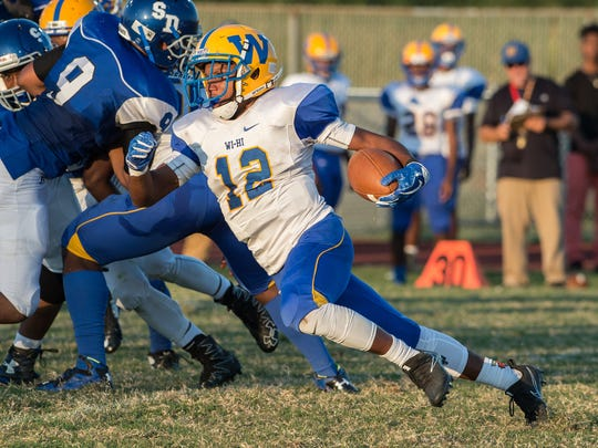 Wi-Hi's Ronnie Satchel (12) carries the ball during a game against Decatur on Friday, Sept. 8, 2017.