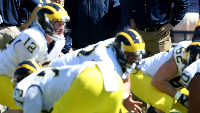 The Michigan football team practices April 4, 2015.