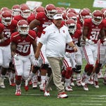 Aug 30, 2014; Bloomington, IN, USA;  Indiana Hoosiers head coach Kevin Wilson leads the team off the field before the game against the Indiana State Sycamores at Memorial Stadium. Indiana won 28-10. Mandatory Credit: Pat Lovell-USA TODAY Sports