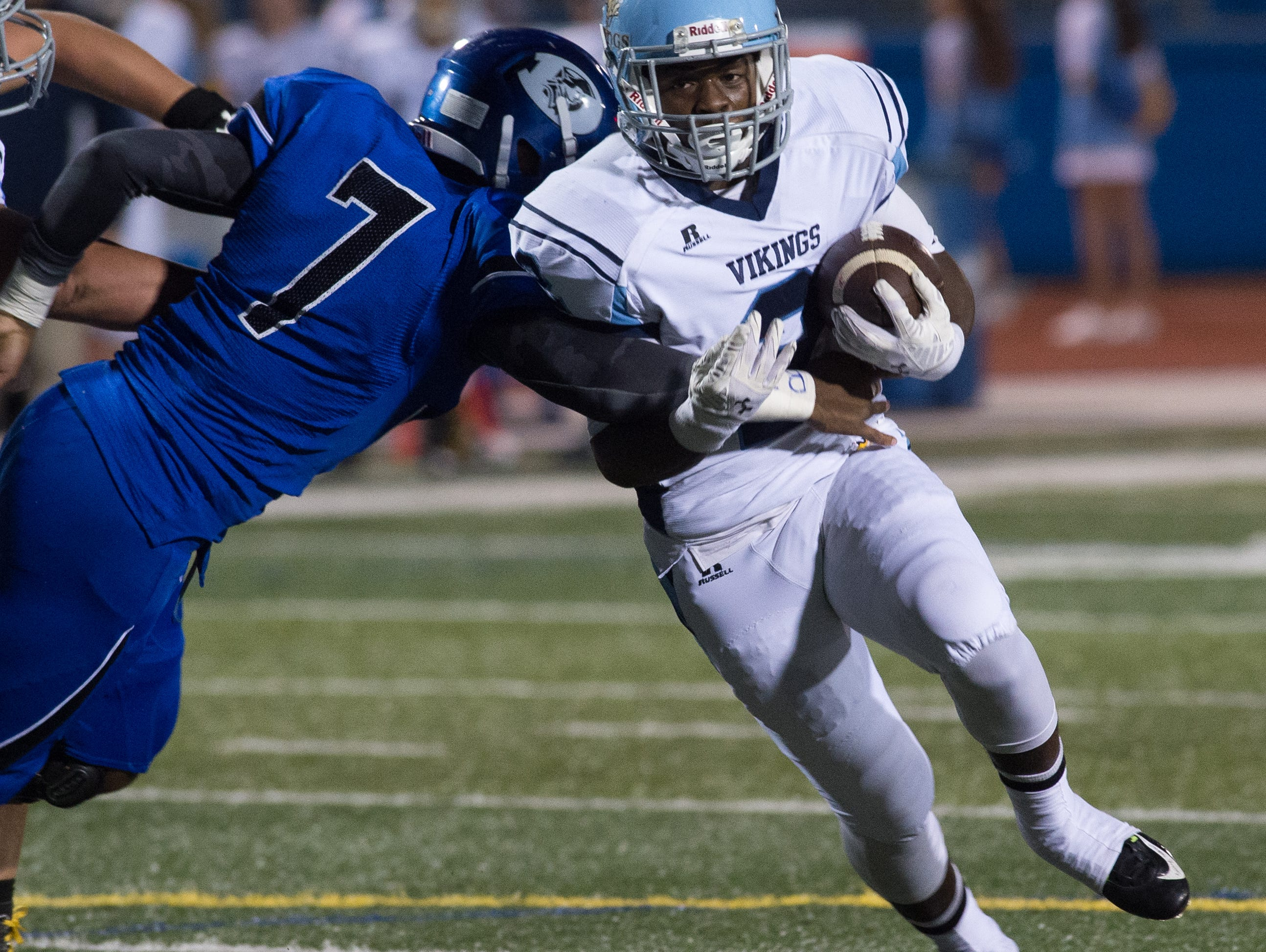 Cape Henlopen's Rasheed Woods (2) runs the ball for a touchdown in the first quarter against Dover.