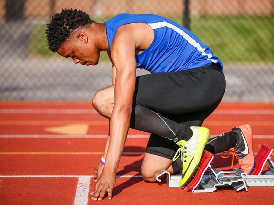 Hamilton Southeastern sprinter Noah Malone waits for the gun to sound during the 200-meter dash prelims in the boys sectional track and field meet at Carmel High School on Thursday, May 18, 2017.